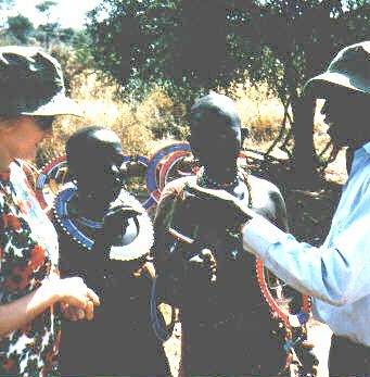 Sc) Buying Bead Collars from the Ladies