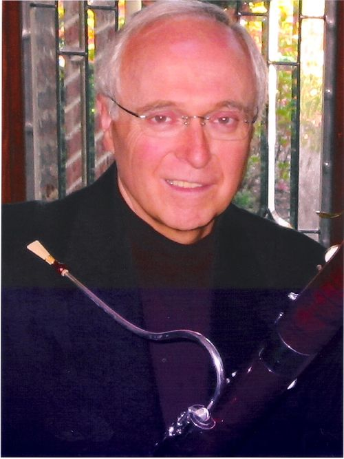 N) John Heard